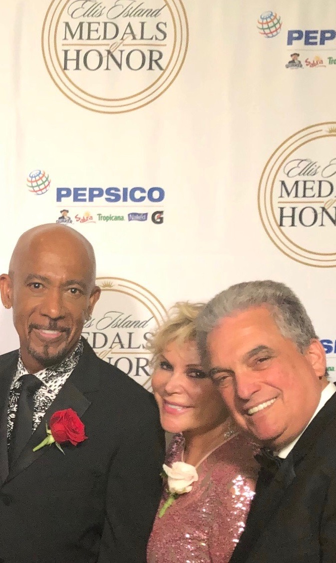 Wendy Federman with fellow Ellis Island Medal of Honor recipient, Montel Williams